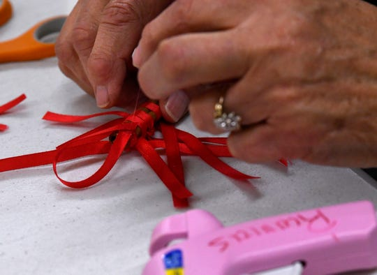 Sharon Engler ties ribbon onto a cinnamon stick during a holiday make-and-take workshop in Ballinger Wednesday Nov. 14, 2018. Put on by the Texas A&M AgriLife Extension office, the workshop assisted participants with creatively making Christmas-themed items with little cost.