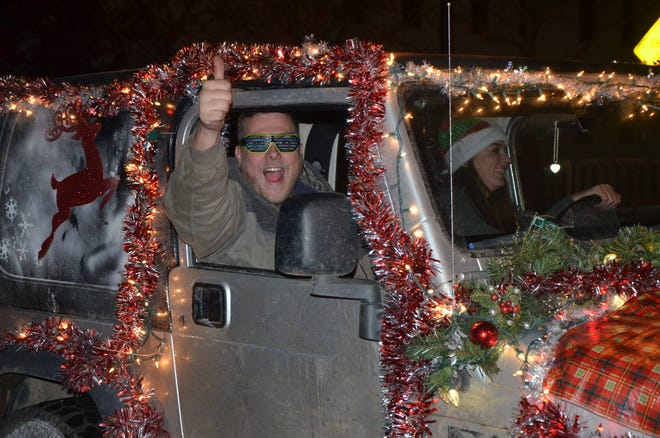 This Nov. 17, 2018 photo shows participants in the annual Battle Creek Christmas Parade presented by the Harper Creek Optimist Club. The 2020 event was canceled due to the pandemic, and is returning Nov. 20, 2021.