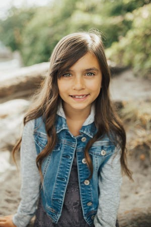 """Olivia Juarez plays Molly in the 5th Avenue Theatre's production of """"Annie."""""""