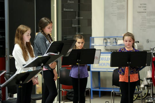 """Olivia Juarez (second from right) rehearses a musical number with fellow """"orphans"""" (from left) Miranda Power, Carolyn Dunbar and Sarah Bennett."""