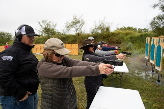 Judge Susan Barclay stands next to the 347th District Judge Missy Medary as they take a license to carry class along with other judges and courthouse workers at Starry Shooting Range on Sunday, Nov. 18, 2018.