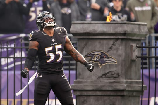 Baltimore Ravens outside linebacker Terrell Suggs (55) is introduced before an NFL football game against the Cincinnati Bengals, Sunday, Nov. 18, 2018, at M&T Bank Stadium in Baltimore.