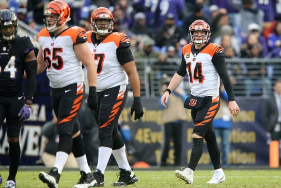 Cincinnati Bengals quarterback Andy Dalton (14) and the offense walk off the field after a stalled drive in the third quarter of an NFL football game,Sunday, Nov. 18, 2018, at M&T Bank Stadium in Baltimore.