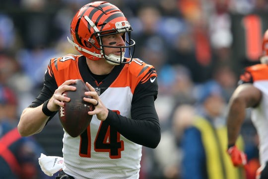 Cincinnati Bengals quarterback Andy Dalton (14) rolls out of the pocket in the first quarter of an NFL football game against the Baltimore Ravens, Sunday, Nov. 18, 2018, at M&T Bank Stadium in Baltimore.