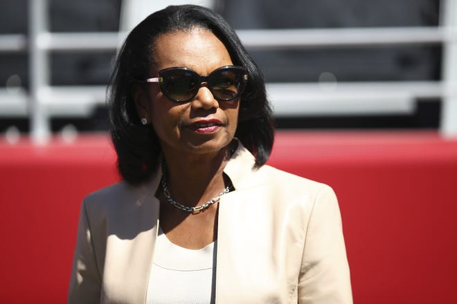 In this Sept. 16, 2018, file photo former Secretary of State Condoleezza Rice stands on the sidelines before the start of an NFL football game between the San Francisco 49ers and the Detroit Lions in Santa Clara, Calif. Cleveland Browns general manager John Dorsey says the team has not discussed Rice as a candidate for its coaching vacancy. Rice is an avid Browns fan and has visited the team's headquarters on numerous occasions in recent years.