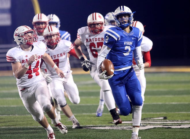 Wyoming quarterback Evan Prater runs for a touchdown during the Cowboys' regional championship win over London Saturday, Nov.17,2018.