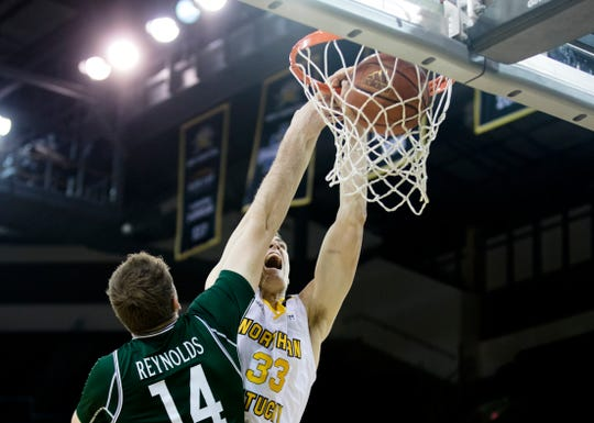 Northern Kentucky Norse center Chris Vogt (33) dunks over Manhattan Jaspers forward Tyler Reynolds (14) as the shot is called off due to a offensive foul away from the ball during the NCAA men's basketball game between Northern Kentucky Norse and Manhattan Jaspers in the Northern Kentucky Basketball Classic tournament on Saturday, Nov. 17, 2018, at NKU's BB&T Arena in Highland Heights, Ky.