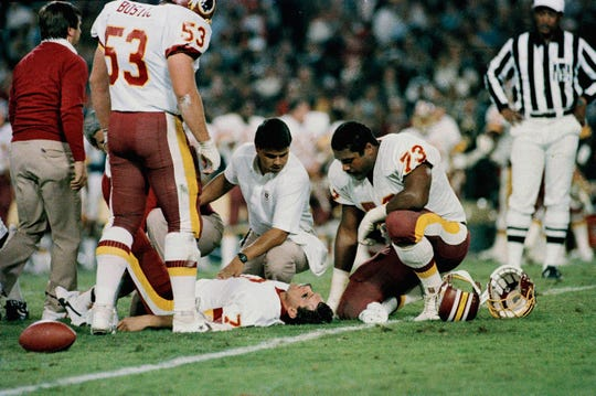 FILE - In this Nov. 18, 1985, file photo, Washington Redskins quarterback Joe Theismann lies on the ground after he injured his right leg during the first half of an NFL game against the New York Giants at RFK Stadium in Washington. Former NFL quarterback Joe Theismann saw the video of Boston Celtics forward Gordon Hayward's broken left ankle and immediately felt a kind of empathy few could.