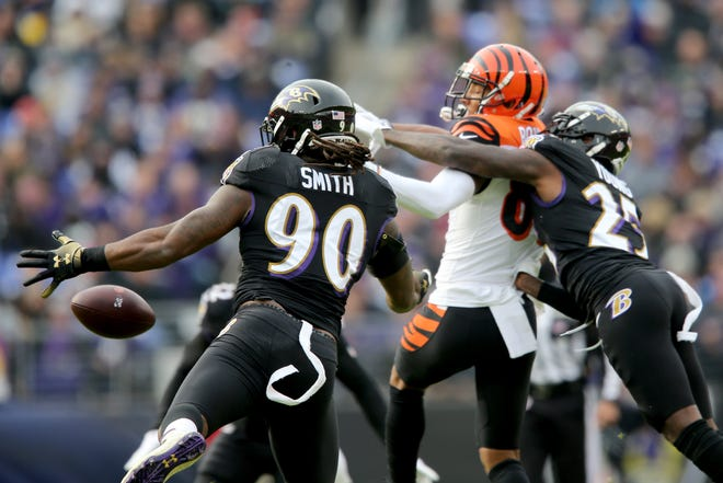 Baltimore Ravens outside linebacker Za'Darius Smith (90) breaks up a pass intended for Cincinnati Bengals wide receiver Tyler Boyd (83) in the first quarter of an NFL football game,Sunday, Nov. 18, 2018, at M&T Bank Stadium in Baltimore.
