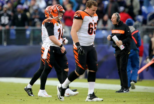 Cincinnati Bengals quarterback Andy Dalton (14), center, returns to the bench after the team is unable to convert a fourth-down play in the fourth quarter of an NFL football game,Sunday, Nov. 18, 2018, at M&T Bank Stadium in Baltimore.