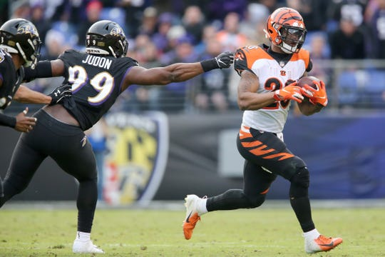 Cincinnati Bengals running back Joe Mixon (28) carries the ball as Baltimore Ravens outside linebacker Matt Judon (99) defends in the fourth quarter of an NFL football game,Sunday, Nov. 18, 2018, at M&T Bank Stadium in Baltimore.