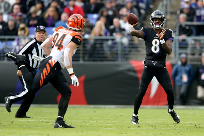 Baltimore Ravens quarterback Lamar Jackson (8) throws in the second quarter of an NFL football game,Sunday, Nov. 18, 2018, at M&T Bank Stadium in Baltimore.