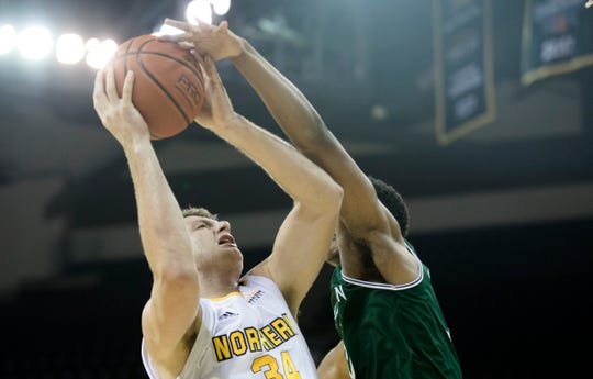 Northern Kentucky Norse forward Drew McDonald (34) is blocked by Manhattan Jaspers guard Christian Hinckson (12) during the NCAA men's basketball game between Northern Kentucky Norse and Manhattan Jaspers in the Northern Kentucky Basketball Classic tournament on Saturday, Nov. 17, 2018, at NKU's BB&T Arena in Highland Heights, Ky.