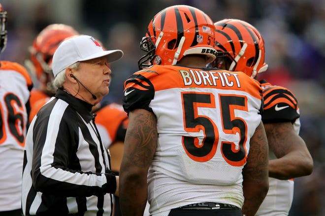 NFL referee Walt Coleman, left, talks with Cincinnati Bengals outside linebacker Vontaze Burfict (55) between plays in the fourth quarter of an NFL football game against the Baltimore Ravens, Sunday, Nov. 18, 2018, at M&T Bank Stadium in Baltimore.