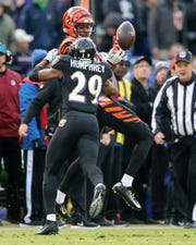 Cincinnati Bengals wide receiver Cody Core (16) is unable to hold on to the ball for a catch on fourth down as Baltimore Ravens cornerback Marlon Humphrey (29) defends in the fourth quarter of an NFL football game, Sunday, Nov. 18, 2018, at M&T Bank Stadium in Baltimore.