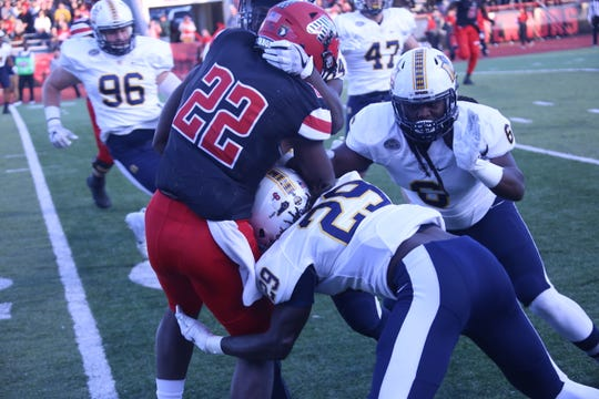 Murray State's defense gang-tackles Austin Peay's Prince Momodu (22) during the first quarter of their OVC game Saturday at Fortera Stadium.