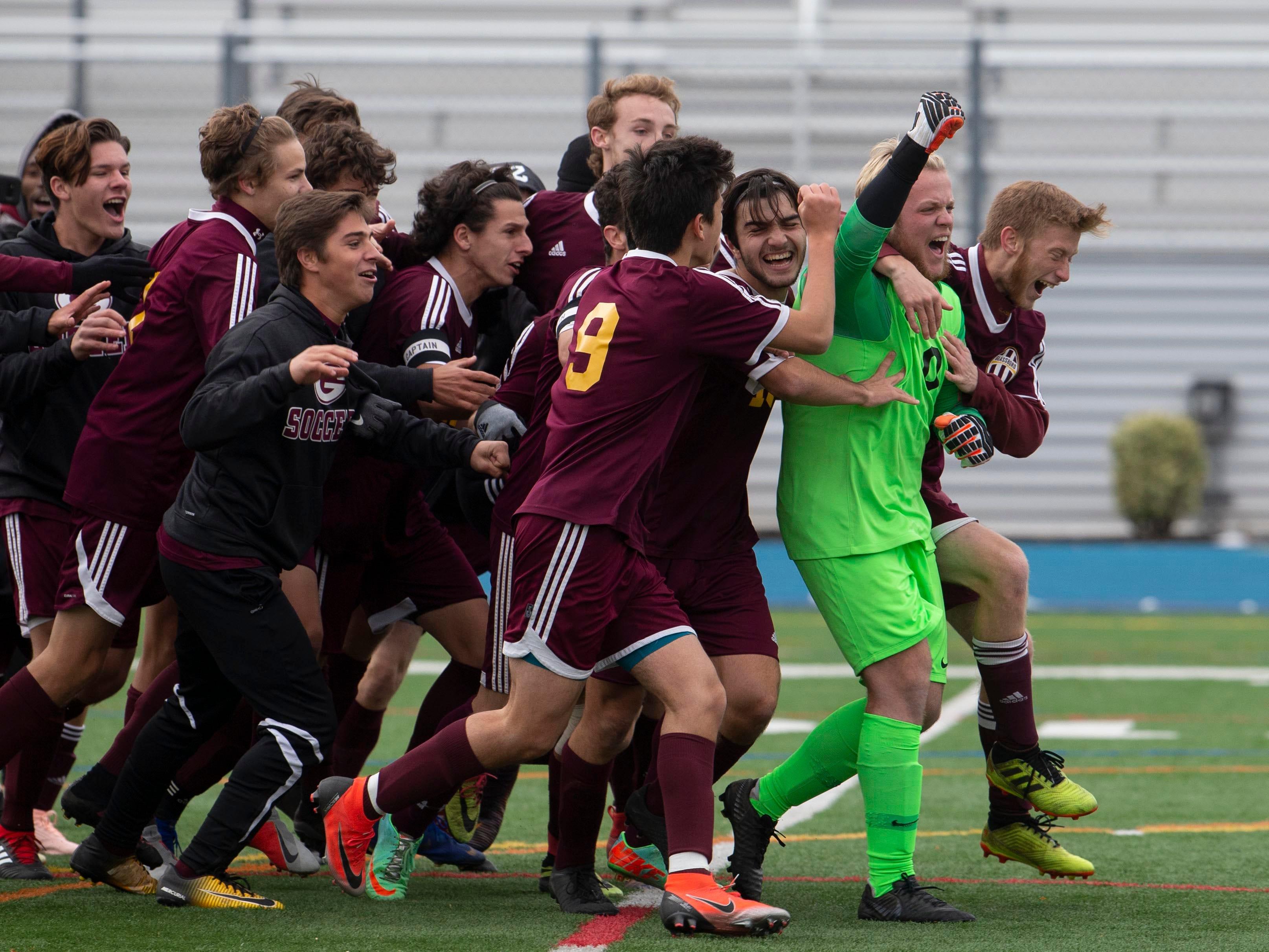 Gllassboro celebrate their state win on penalty kicks. New Providence vs. Glassboro in Boys Group I Soccer in Union NJ.