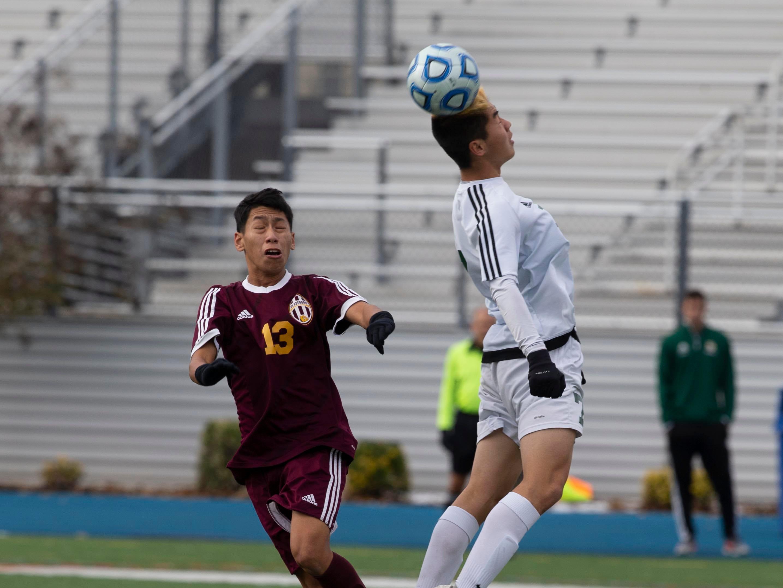 New Providence's Ben Peng heads the ball during regulation play. New Providence vs. Glassboro in Boys Group I Soccer in Union NJ.