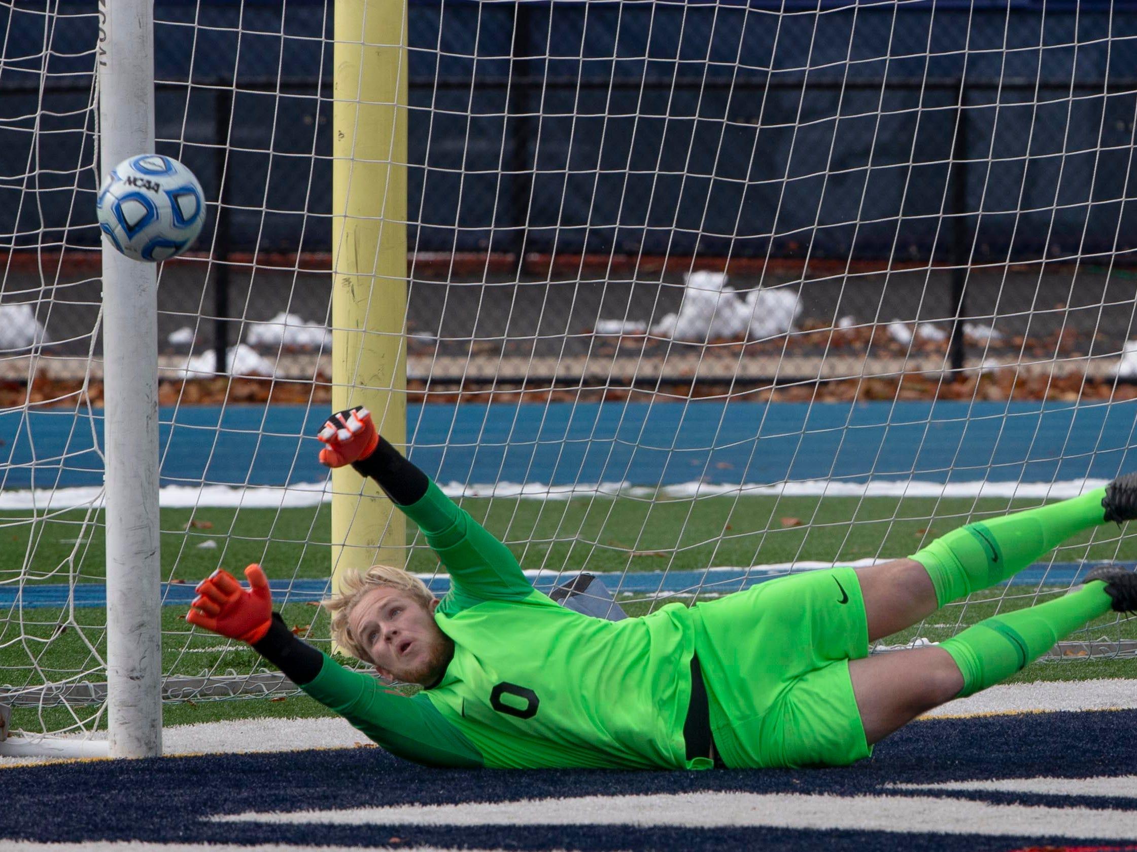 Glassboro goalie Griffin Rogers knocks away a shot on goal New Providence vs. Glassboro in Boys Group I Soccer in Union NJ.