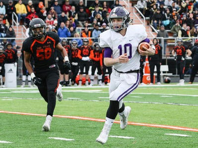 Rumson-Fair Haven quarterback Colin Coles runs the ball during the first half against Somerville in the Central Group III final on Sunday, Nov. 18, 2018 at Somerville.
