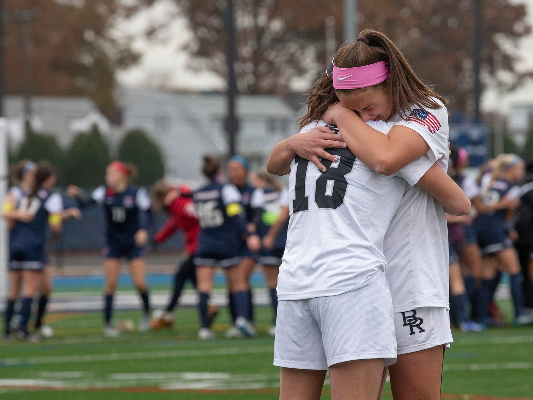 Bridgewater-Raritan's Gianna Minerva and Allison Lowrey console each other after a heartbreaking 1-0 loss to Eastern.  Bridgewater-Raritan vs. Eastern girls soccer in the NJSIAA Group IV final at Kean University.
