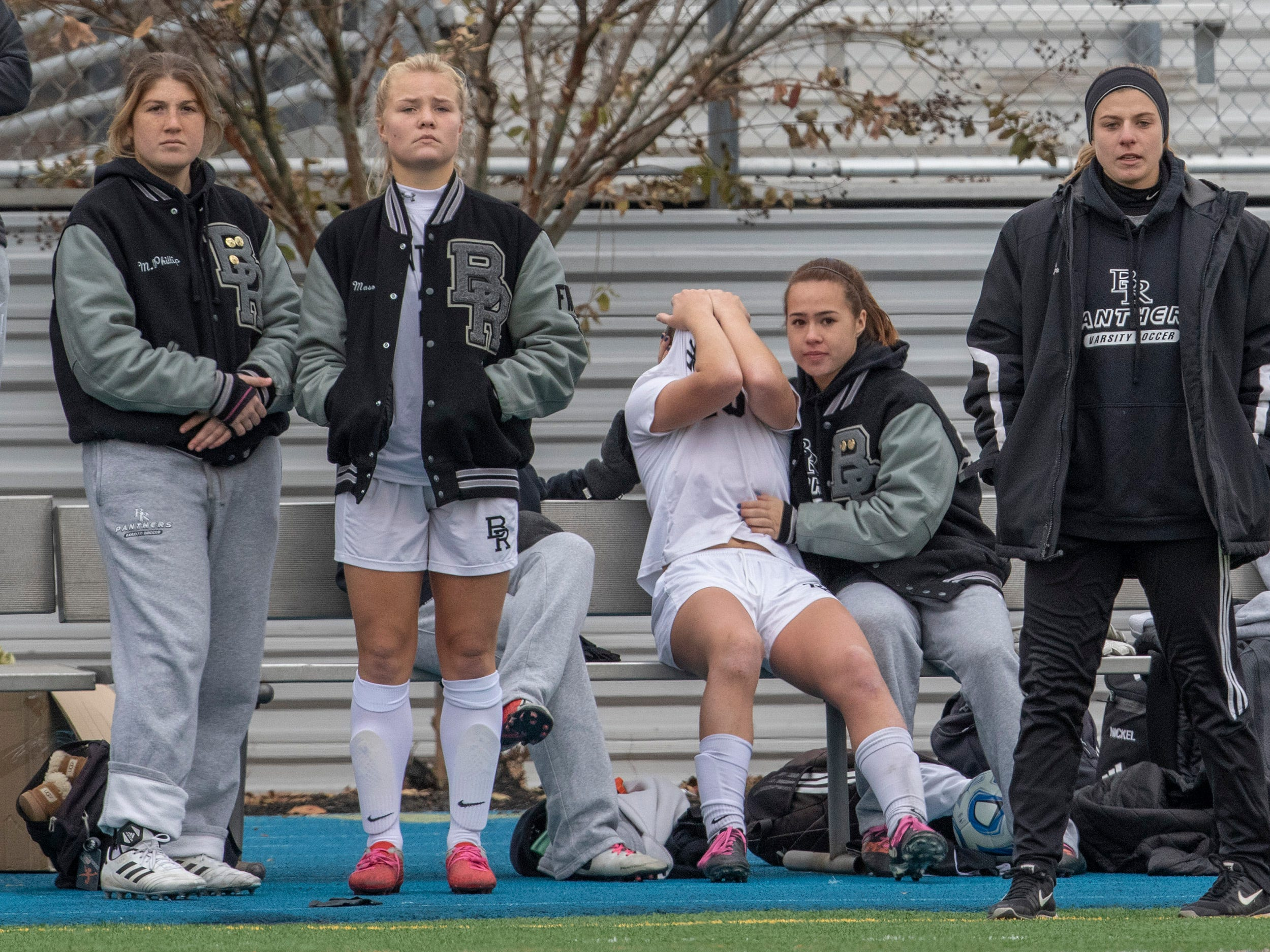 An upset Allison Lynch hides her face because she can't play after being injured. Bridgewater-Raritan vs. Eastern girls soccer in the NJSIAA Group IV final at Kean University.