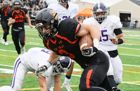 Somerville's Robert Fiorentino runs the ball against Rumson-Fair Haven during the first half of the Central Group III final on Sunday, Nov. 18, 2018 at Somerville.