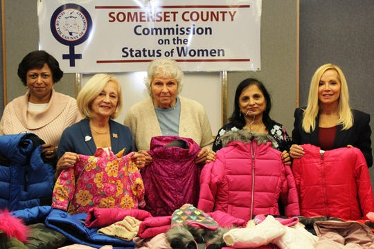 Pictured left to right with some of the donated coats are commission member Vaseem Firdaus; Freeholder Pat Walsh; Food Bank Network Executive Director Marie Scannell; and commission members Smriti Agrawal and Janice Fields.