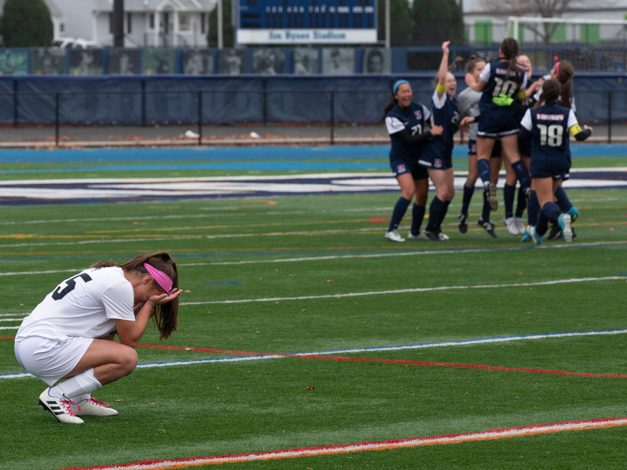 Bridgewater-Raritan's Allison Lowrey tries to accept heartbreaking 1-0 loss to Eastern as they celebrate at midfield. Bridgewater-Raritan vs. Eastern girls soccer in the NJSIAA Group IV final at Kean University.