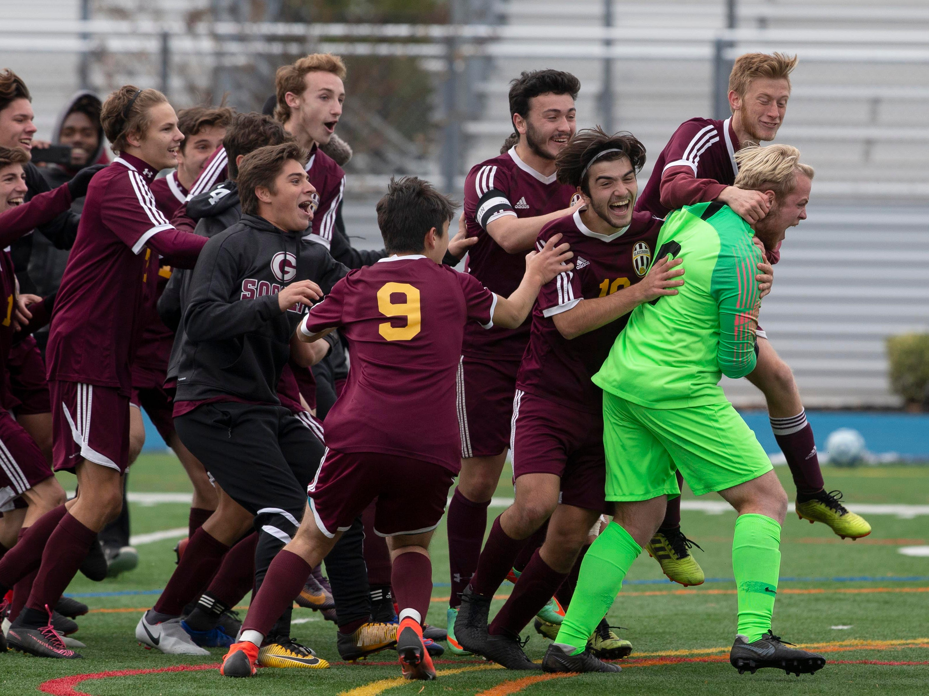 Glassboro celebrate their 1-0 in in OT on penalty kicks. New Providence vs. Glassboro in Boys Group I Soccer in Union NJ.