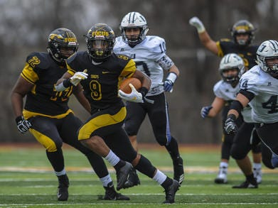 Piscataway's	Juwon Jackson (9) breaks free for extra yards against Union City during the NJSIAA North 2 Group V final on Saturday, Nov. 17, 2018.