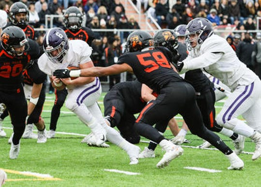 Rumson-Fair Haven's Alex Maldjlan runs the ball during the first half against Somerville in the Central Group III final on Sunday, Nov. 18, 2018 at Somerville.