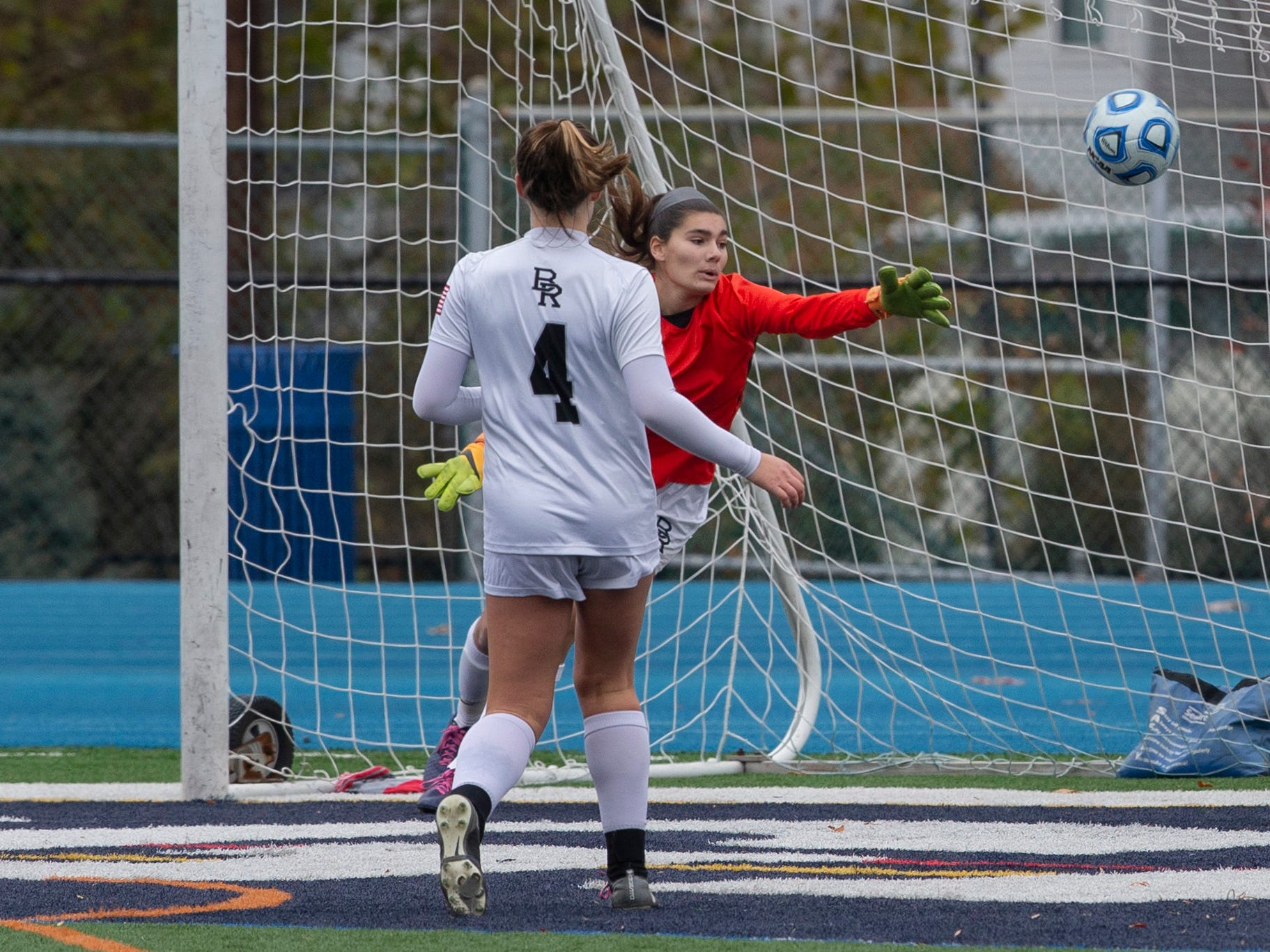 Eastern's Kelli McGroarty (10) watches as her shot gets by Bridgewater Raritan goalie Maggie Ousouljoglou for game winning goall. Bridgewater-Raritan vs. Eastern girls soccer in the NJSIAA Group IV final at Kean University.