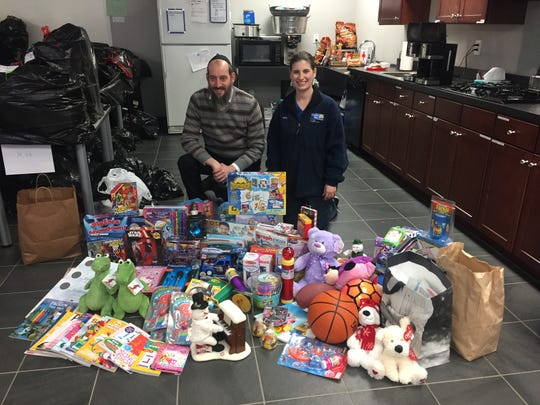 United Way's Amy Andersen and Rabbi Kornfeld, who is dropping off the annual Chabad of Hunterdon toy donation to support Holiday Hands.