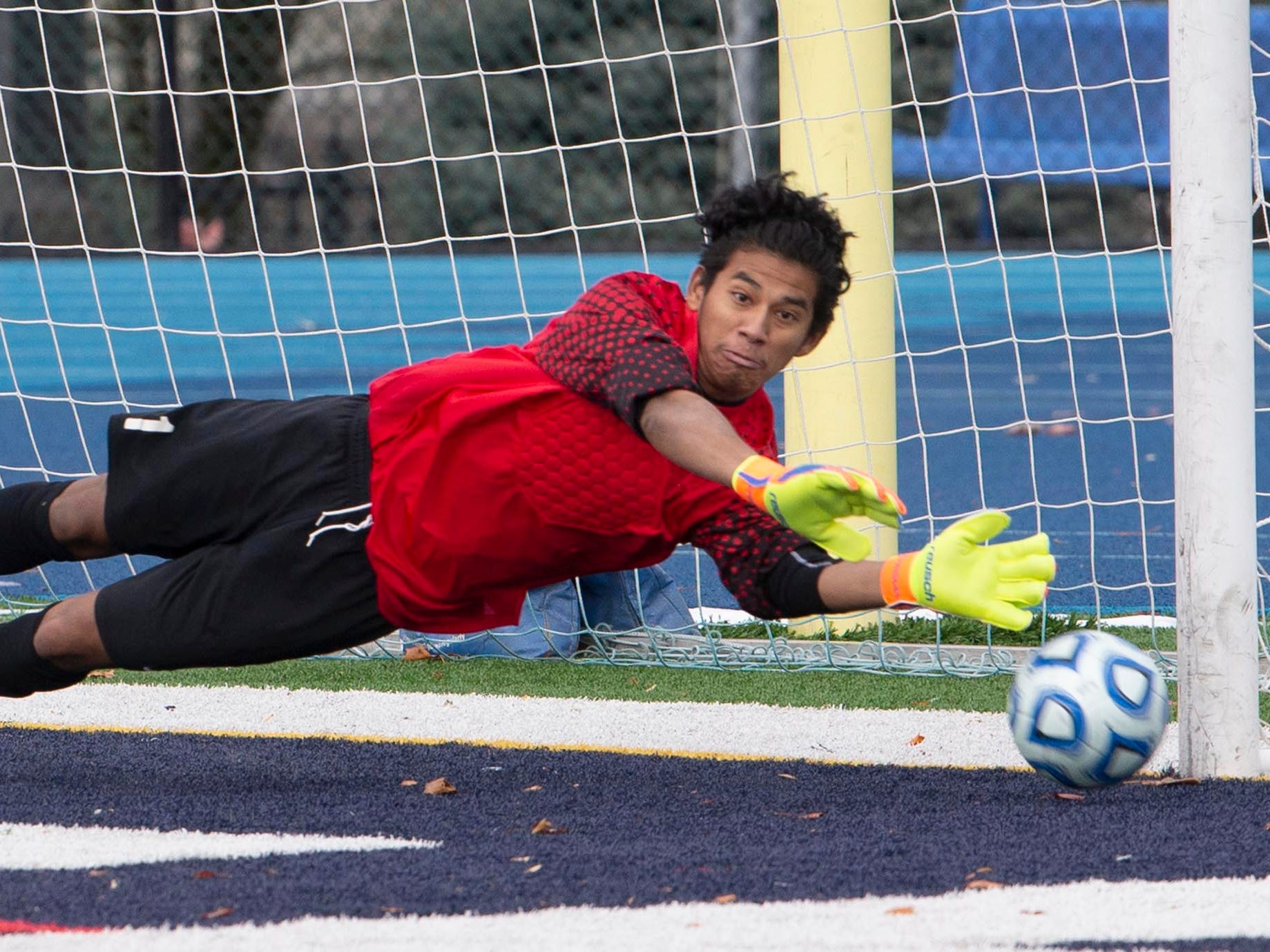 New Providence's Miguel Garcia makes one of several saves in regulation although he was bested finally during penalty kicks in OT. New Providence vs. Glassboro in Boys Group I Soccer in Union NJ.