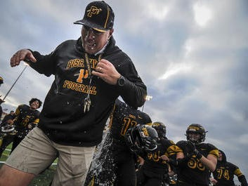 Members of the Piscataway football team give coach Dan Higgins a celebratory victory shower after defeating Union City 28-7 in the NJSIAA North 2 Group V final on Saturday, Nov. 17, 2018 in Piscataway.