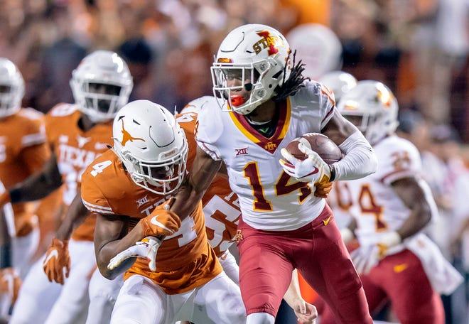 Nov 17, 2018; Austin, TX, USA; Iowa State Cyclones wide receiver Tarique Milton (14) returns the Texas Longhorns kick during the first quarter at Darrell K Royal-Texas Memorial Stadium. Mandatory Credit: John Gutierrez-USA TODAY Sports