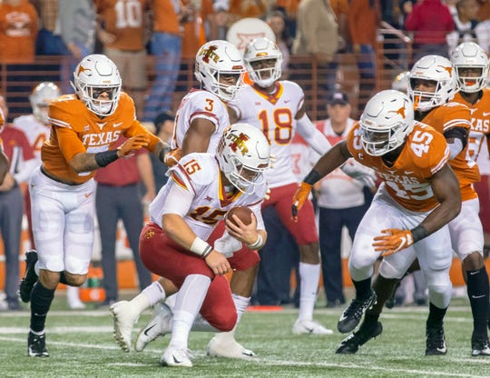 Nov 17, 2018; Austin, TX, USA; Iowa State Cyclones quarterback Brock Purdy (15) is brought down by Texas Longhorns linebacker Anthony Wheeler (45) during the first quarter at Darrell K Royal-Texas Memorial Stadium. Mandatory Credit: John Gutierrez-USA TODAY Sports