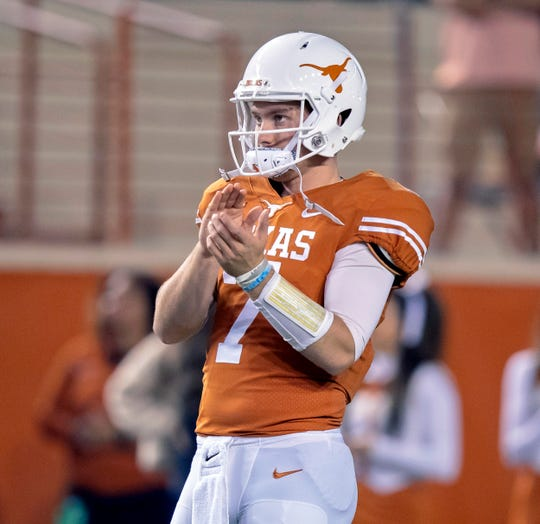 Nov 17, 2018; Austin, TX, USA; Texas Longhorns quarterback Shane Buechele (7) claps congratulating senior player announcements before the game against the Iowa State Cyclones at Darrell K Royal-Texas Memorial Stadium. Mandatory Credit: John Gutierrez-USA TODAY Sports