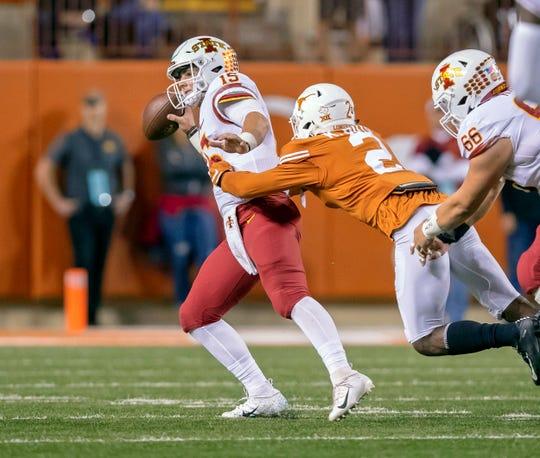 Nov 17, 2018; Austin, TX, USA; Iowa State Cyclones quarterback Brock Purdy (15) is sacked by Texas Longhorns defensive back Kris Boyd (2) during the first quarter at Darrell K Royal-Texas Memorial Stadium. Mandatory Credit: John Gutierrez-USA TODAY Sports