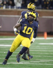 Michigan's Devin Bush celebrates his sack vs. Indiana, Saturday, Nov. 17, 2018 at Michigan Stadium in Ann Arbor.