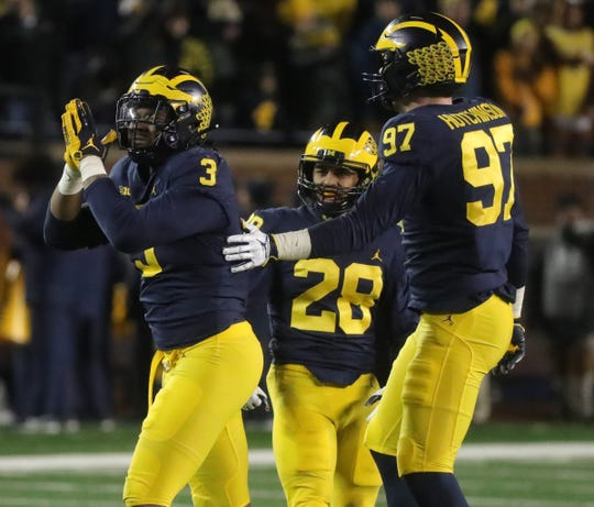 Michigan's Rashan Gary, left, celebrates his sack against Indiana with Aidan Hutchinson, right, during the second half Saturday, Nov. 17, 2018 at Michigan Stadium in Ann Arbor.