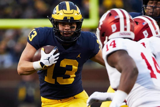 Michigan running back Tru Wilson rushes against Indiana in the first half at Michigan Stadium on Nov. 17, 2018 in Ann Arbor.