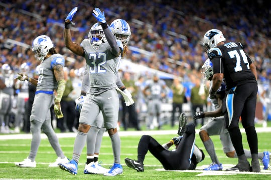Detroit Lions safety Tavon Wilson celebrates after a stop against the Carolina Panthers in the second half on Sunday, November 18, 2018 at Ford Field in Detroit.
