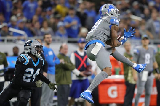 Detroit Lions receiver Kenny Golladay makes a catch against Carolina Panthers cornerback James Bradberry in the second half on Sunday, November 18, 2018 at Ford Field.
