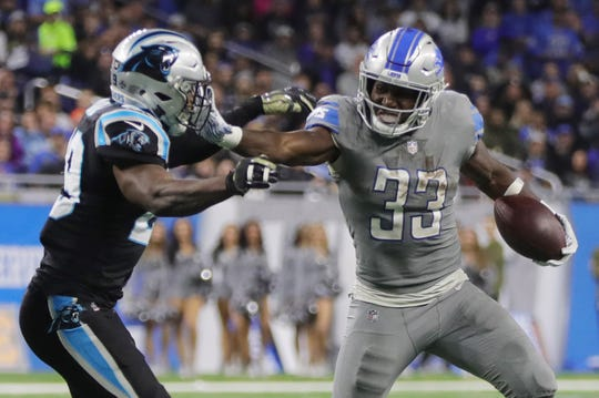 Detroit Lions running back Kerryon Johnson runs the ball against Carolina Panthers safety Mike Adams in the second half on Sunday, November 18, 2018 at Ford Field.