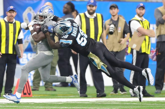 Lions running back Kerryon Johnson is tackled by Panthers linebacker Thomas Davis during the first half Sunday, Nov. 18, 2018, at Ford Field.