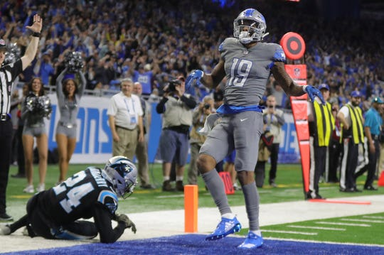 Detroit Lions receiver Kenny Golladay celebrates his game-winning TD catch against Carolina Panthers cornerback James Bradberry in the second half Sunday, Nov. 18, 2018 at Ford Field in Detroit.