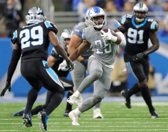 Detroit Lions running back Theo Riddick runs by Carolina Panthers safety Mike Adams in the second half on Sunday, November 18, 2018 at Ford Field.