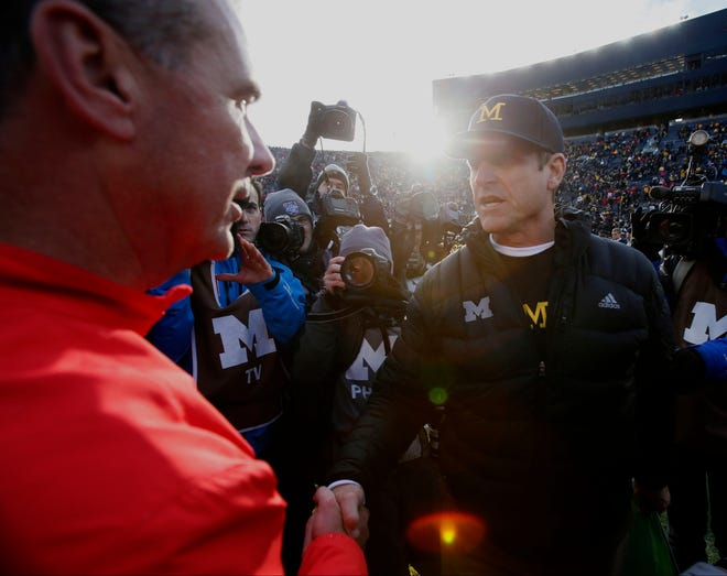Michigan's Jim Harbaugh shakes hands with Ohio State's Urban Meyer on Nov. 28, 2015, in Ann Arbor.